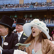 Spectators in the Grandstand at Royal Ascot, cheer at the finish line during the Royal Ascot race meeting. Royal Ascot. England, UK. June 16-20th, 2009. Photo Tim Clayton
