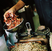 Spices being weighed on scales ,Kerala, India