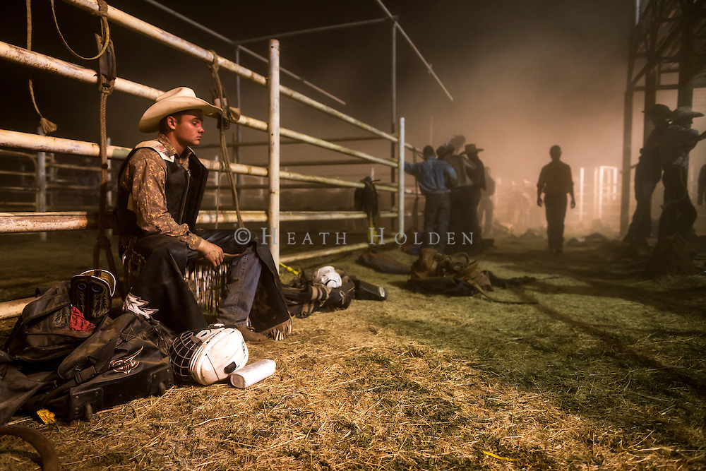A bull rider takes some time out after a bad ride at the Tennant Creek rodeo.