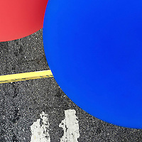 Balloons are tied to a police line barrier during a Democratic National Convention themed street festival on Passayunk Avenue on the third day of events in Philadelphia, PA on July 27, 2016.