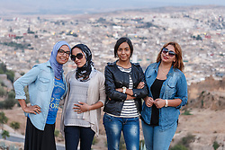 Portraits of Moroccan women with background of Fes al Bali medina, Fes, Morocco