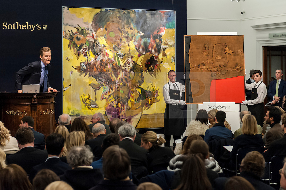 """© Licensed to London News Pictures. 10/02/2016. London, UK.  (L to R) Adrian Ghenie's """"The Sunflowers"""" and Alberto Burri's """"Sacco e Rosso"""", which sold for a hammer price of £14.2m and £8.0m respectively, at Sotheby's Contemporary Art evening sale in New Bond Street.   Photo credit : Stephen Chung/LNP"""