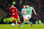 Kieran Tierney (#63) of Celtic plays a short pass during the Betfred Cup Final between Celtic and Aberdeen at Celtic Park, Glasgow, Scotland on 2 December 2018.