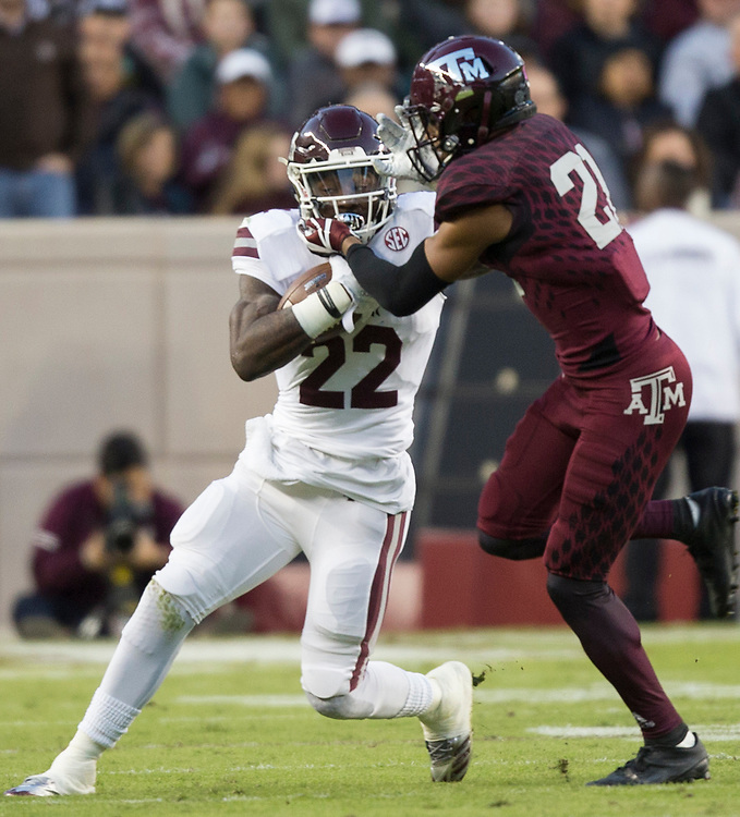 Mississippi State running back Aeris Williams (22) fights off Texas A&M defensive back Charles Oliver (21) during the first quarter of an NCAA college football game on Saturday, Oct. 28, 2017, in College Station, Texas. (AP Photo/Sam Craft)