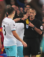 Football - 2016 / 2017 Premier League - Crystal Palace vs. West Ham United<br /> <br /> Referee Martin Atkinson sends Aaron Cresswell of West ham off for two yellow cards at Selhurst Park.<br /> <br /> COLORSPORT/ANDREW COWIE