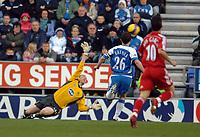 Photo: Paul Greenwood.<br />Wigan Athletic v Liverpool. The Barclays Premiership. 02/12/2006. Craig Bellamy (unseen) shoots over the despairing hand of Wigan goalkeeper Chris Kirkland