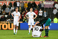 Football - 2017 / 2018 Premier League - Swansea City vs. Southampton<br /> <br /> Tammy Abraham of Swansea City is consoled by Jack Stephens of Southampton on the pitch after the final whistle, at Liberty Stadium.<br /> <br /> COLORSPORT/WINSTON BYNORTH