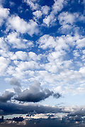 Cumulus Cloudscape white clouds in blue sky background
