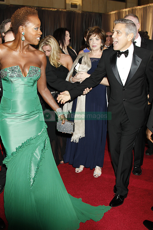 Viola Davis and George Clooney arrive at the 84th annual Academy Awards held at the Kodak Theatre in Los Angeles on February 26, 2012.