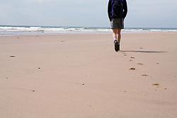 Man walking on a beach,