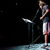 091014       Cable Hoover<br /> <br /> Singer and poet Martin Williams recites a song on stage during the Gallup's Got Talent open mic night at El Morro Theatre in Gallup Wednesday.
