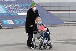 © Licensed to London News Pictures. 11/01/2021. London, UK.Elderly people leave  the Excel Centre Nightingale Hospital after receiving a Covid-19 vaccination jab. The hub is one of a few hubs around the Uk to administer mass vaccination jabs. Photo credit: Ray Tang/LNP