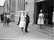 28/07/1962<br /> 07/28/1962<br /> 28 July 1962 <br /> Wedding of Mr Desmond F. English, Landscape Cresent, Churchtown and Miss Blanche O'Brien Oakley Park, Blackrock at St John the Baptist Church, Blackrock and Ross's Hotel Dun Laoghaire, Dublin. Image shows the bride entering the church with her father Mr W. O'Brien and her bridesmaid.