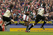 © Peter Spurrier / Sportsbeat images<br />email images@sportsbeat.co.uk - Tel +44 208 876 8611<br />Photo Peter Spurrier 02/05/2003<br />2003 - Zurich Premiership Rugby - Leicester Tigers v London Irish<br />Tigers's Leon lloyd tracked by Paul Sackey right and Rob Hoadley