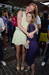 Left to right, OLIVIA INGE and LUCY HAWKES attending the Warner Bros. & Esquire Summer Party held at Shoreditch House, Ebor Street, London E1 on 18th July 2013.