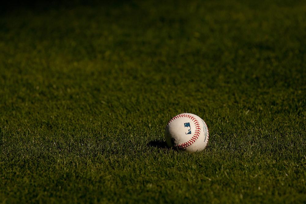 Baseball in grass infield pre-game. Detroit Tigers at Texas Rangers. Photographed at Rangers Ballpark in Arlington in Arlington, Texas on Saturday, April 24, 2010. Photograph © 2010 Darren Carroll