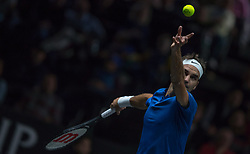 September 23, 2017 - Prague, Czech Republic - Team Europe player Roger Federer of Switzerland serves against Team World player Sam Querrey of United States during the second day at Laver Cup on Sept 23, 2017 in Prague, Czech Republic.  The Laver Cup consists of six European players competing against their counterparts from the rest of the World. Europe will be captained by Bjorn Borg and John McEnroe will captain the Rest of the World team. The first Laver Cup held in Europe, at the O2 arena Prague from September 22-24, 2017. (Credit Image: © Robert Szaniszlo/NurPhoto via ZUMA Press)