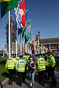 Police presence underneath flags of the Commonwealth flying to celebrate the week of Commonwealth Heads of Government Meeting in London, England, United Kingdom.