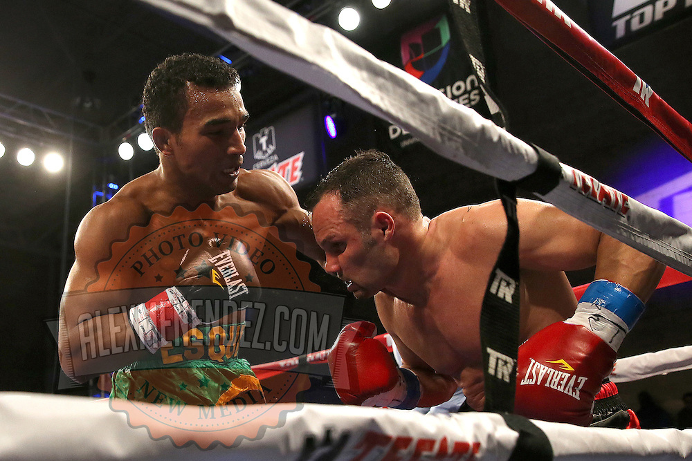 TAMPA, FL - FEBRUARY 28:  Esquiva Falcao (L) punches Mike Tufariello during the SoloBoxeo Tecate boxing match at the University of South Florida Sundome on February 28, 2015 in Tampa, Florida. Falcao won the bout by knockout.  (Photo by Alex Menendez/Getty Images) *** Local Caption *** Esquiva Falcao; Mike Tufariello