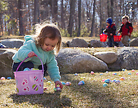 Plenty of eggs to choose from as Lexi fills her basket during the Weirs Beach Community Center annual Easter egg hunt on Saturday morning.  (Karen Bobotas/for the Laconia Daily Sun)