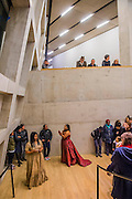 Aluminum - New York-based choreographer Rashida Bumbray  (pictured red dress)  collaborates with Simone Leigh (pictured beige dress) on an immersive dance performance. The performance begins in the Tanks at and proceeds through the Switch House, pausing on Level 4 around and concluding in Tate Exchange. London 26 Nov 2016.