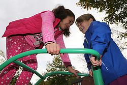 Girls playing in urban park