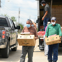 El Cenizo, TX USA Sept. 17, 2020: Local volunteers distribute dozens of food boxes to the colonia of El Cenizo about 10 miles south of Laredo along the Texas-Mexico border. About 450 families are served twice a week with staples and fresh fruit in an effort sponsored by Latin American Lutheran Mission (LALM).