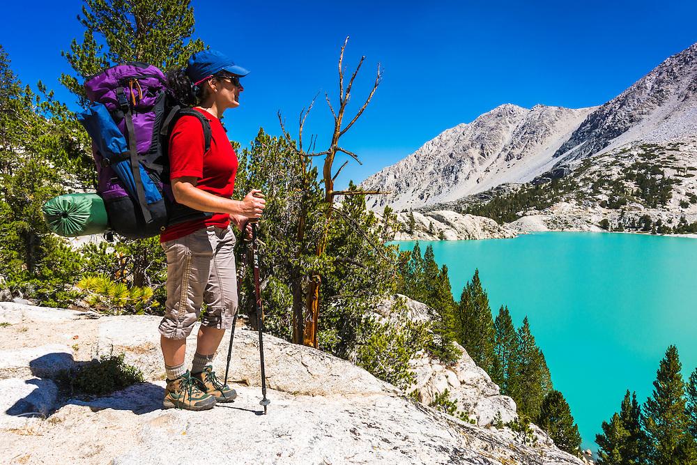 Backpacker at First Lake, Big Pine Lakes, John Muir Wilderness, California USA