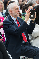 © Licensed to London News Pictures. 24/04/2018. London, UK. © Licensed to London News Pictures. 24/04/2018. London, UK.  JEREMY CORBYN MP, Leader of the Labour Party uses his mobile phone at the statue unveiling of the Suffragist leader Millicent Fawcett in Parliament Square. The Mayor of London commissioned Turner prize-winning artist GILLIAN WEARING OBE to create the statue. Photo credit: Ray Tang/LNP