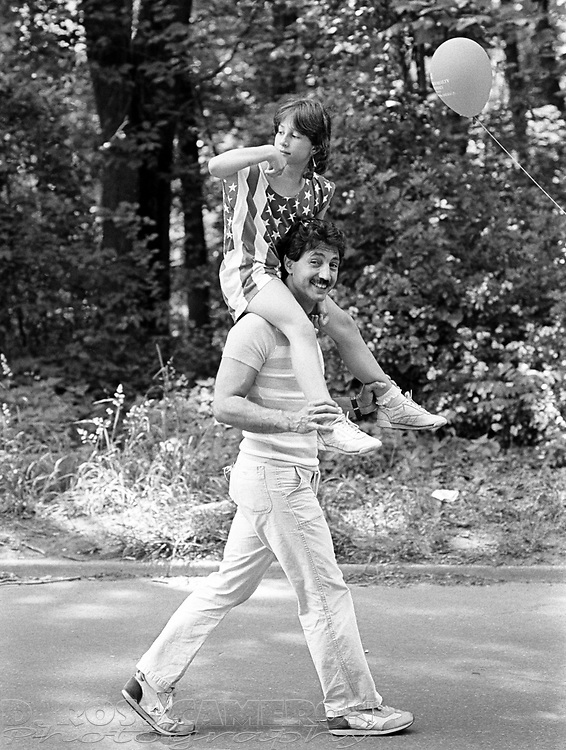 Unidentified participants in Hands Across America, the fundraiser to combat hunger and homelessness in the United States, walk back to their car after the event concluded, Sunday, May 26, 1986 in Princeton, N.J.  Nearly seven million people are believed to have taken part in the event, which had one end in New York and the other in Long Beach, Calif. (D. Ross Cameron/North Jersey Advance)