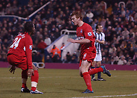 John Arne Riise celebrates scoring the 1st Liverpool goal with Florent Sinama Pongolle. West Bromwich Albion v Liverpool, FA Premiership, 26/12/2004. Credit: Back Page Images / Matthew Impey