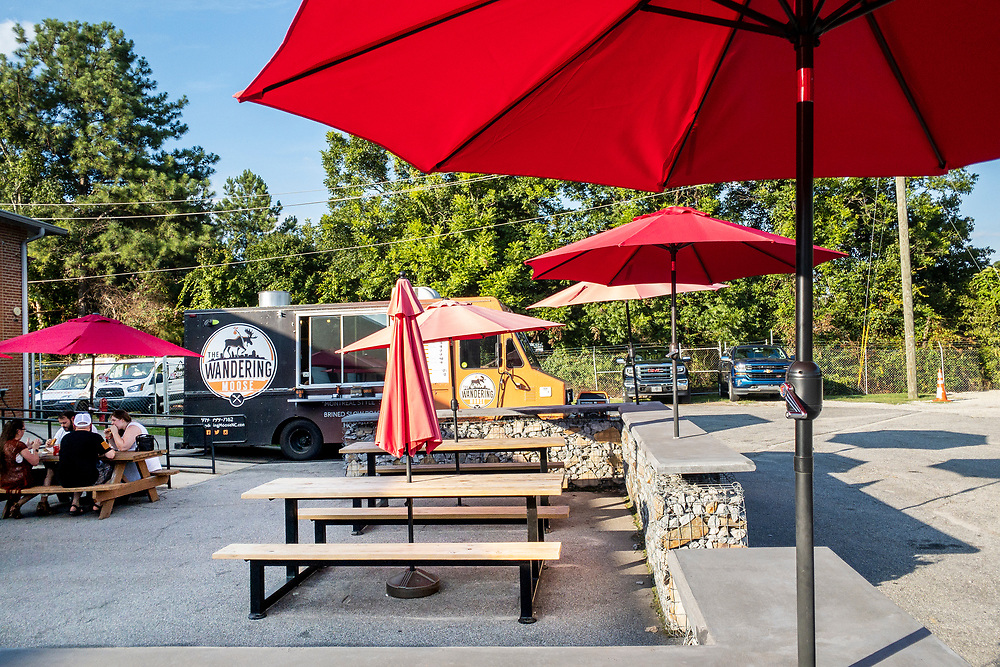 A food truck and outdoor seating at Deep River Brewing Company in Clayton, North Carolina on Thursday, August 19, 2021. Copyright 2021 Jason Barnette