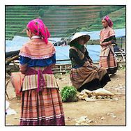 Hmong flower women wearing beautiful ethnic dress in Can Cau market, Bac Ha, Vietnam, Asia