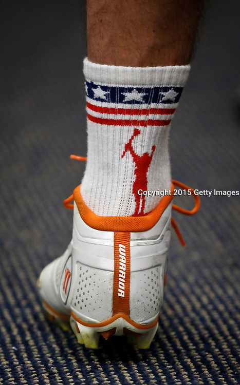 DENVER, CO - JULY 4: John Grant Jr. of the Denver Outlaws sports some patriotic socks with his cleats before playing the Boston Cannons during their MLL game at Sports Authority Field at Mile High on July 4, 2015 in Denver, Colorado. (Photo by Marc Piscotty/Getty Images) *** Local Caption *** John Grant Jr.