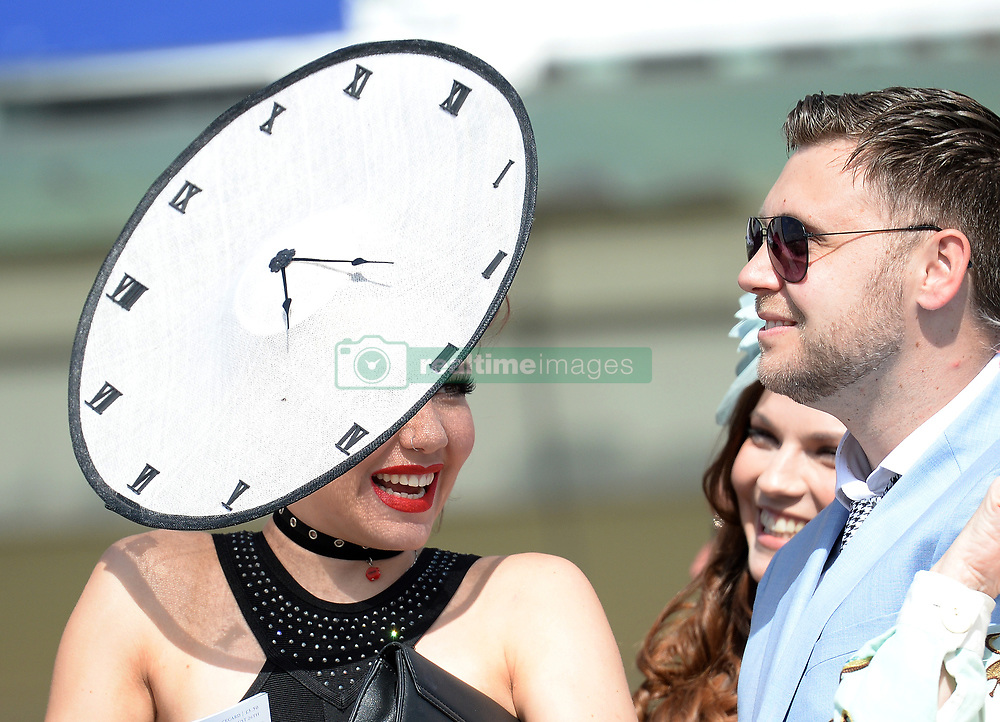 A racegoer wears an unusual hat during day four of the 2017 Yorkshire Ebor Festival at York Racecourse.