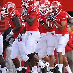 Oct 10, 2009; Piscataway, NJ, USA; Rutgers cornerback David Rowe (4) celebrates with teammates after his interception return for a touchdown during first half NCAA college football action between Rutgers and Texas Southern at Rutgers Stadium.