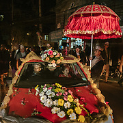 The decorated car carrying the groom to the bride's home in a parade called Janti.