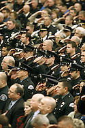 Offices salute during the funeral service for slain King County sheriff's deputy Steve Cox in SeaTac, WA. (AP Photo/John Froschauer Pool).