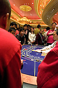Gamblers play Baccarat in Venetian casino, in Macao, China, on December 17, 2009. Photo by Lucas Schifres/Pictobank