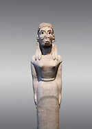 Pentelic marble Ancient Greek Archaic statue of a female, found in Pyoan Apollo Sanctuart, Boeotia, end 7th cent BC, Athens National Archaeological Museum. Cat no 4. Against grey.<br /> <br /> two of these staues suppoted t a perrihanterion, a shallow basin, in the snctuary of Apollo Boeotia. This style originated in Syria na dcCyprus. Sculpted in a Boeotian workshop. .<br /> <br /> If you prefer to buy from our ALAMY STOCK LIBRARY page at https://www.alamy.com/portfolio/paul-williams-funkystock/greco-roman-sculptures.html . Type -    Athens    - into LOWER SEARCH WITHIN GALLERY box - Refine search by adding a subject, place, background colour, etc.<br /> <br /> Visit our ROMAN WORLD PHOTO COLLECTIONS for more photos to download or buy as wall art prints https://funkystock.photoshelter.com/gallery-collection/The-Romans-Art-Artefacts-Antiquities-Historic-Sites-Pictures-Images/C0000r2uLJJo9_s0