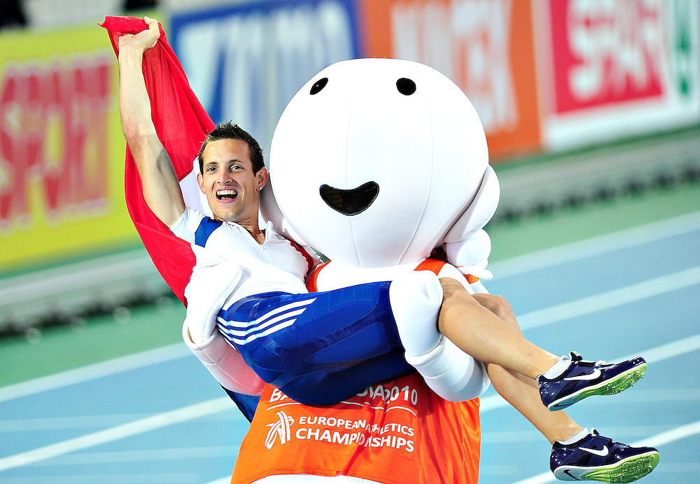 France's Renaud Lavillenie celebrates his victory with B10 mascot Barni at the end of the men's pole vault final at the 2010 European Athletics Championships at the Olympic Stadium in Barcelona on July 31, 2010.