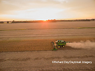 63801-09110 Soybean Harvest, John Deere combine harvesting soybeans at sunset - aerial - Marion Co. IL