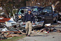 24 February 2016. Sugar Hill RV Park, Convent, Louisiana.<br /> Scenes of devastation following a deadly EF2 tornado touchdown. 2 confirmed dead. <br /> Law enforcement helps recover family belongings from the flipped trailers and cars dotting the landscape.<br /> Photo©; Charlie Varley/varleypix.com