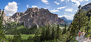 Vallunga/Langental, Puez Group, Dolomites, South Tyrol, Italy, Europe. The beautiful ski resort of Selva di Val Gardena (German: Wolkenstein in Gröden; Ladin: Sëlva Gherdëine) makes a great hiking base in the Trentino-Alto Adige/Südtirol (South Tyrol) region of Italy. For our favorite hike in the Dolomiti, start from Selva with the first morning bus to Ortisei or St. Christina, take the Seceda lift, admire great views up at the cross on the edge of Val di Funes (Villnöss), then walk 12 miles (2000 feet up, 5000 feet down) via the steep pass Furcela Forces De Sieles (Forcella Forces de Sielles) to beautiful Vallunga (trail #2 to 16), finishing where you started in Selva. The hike traverses the Geisler/Odle and Puez Groups from verdant pastures to alpine wonders, all preserved in a vast Nature Park: Parco Naturale Puez-Odle (German: Naturpark Puez-Geisler; Ladin: Parch Natural Pöz-Odles), including the deeply glaciated U-shaped valley of Vallunga (Langental). As sheep and cows graze en route, Saint Sylvester's Chapel (San Silvestro) in Vallunga is fittingly dedicated to the patron saint of cattle and contains 300-year-old frescoes depicting the life of Jesus. UNESCO honored the Dolomites as a natural World Heritage Site in 2009. This panorama was stitched from 8 overlapping photos.