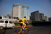 Vehicles and people pass on Beijing Financial Street or BFS (often called China's Wall Street) is an area which offers a collaborative environment for foreign and domestic financial institutions and Chinese regulatory agencies. It is part of the city's strategic plan to position Beijing as a domestic centre for business and finance. The area is gaining prominence as an internationally influential business and financial district.