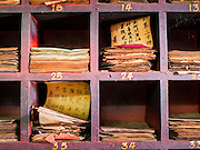 27 DECEMBER 2014 - PHUKET TOWN, PHUKET, THAILAND: Chinese notes used in fortune telling at Pud Jor Shrine, a large Chinese shrine in Phuket town. Phuket has a large Chinese minority that is active in business and civic life.    PHOTO BY JACK KURTZ