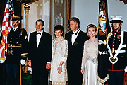 U.S. President Bill Clinton, center, stands with First Lady Hillary Clinton, right, and British Prime Minister Tony Blair and Cherie Blair as they arrive for the State Dinner at the White House February 5, 1998 in Washington, DC.