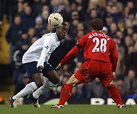 Photo. Daniel Hambury.<br /> Carling Cup.<br /> Tottenham Hotspur v Liverpool. 1/12/2004.<br /> Spur's Rohan Ricketts and Liverpool's Stephen Warnock