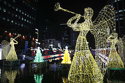 December 18, 2018 - Seoul, SOUTH KOREA - Visitors enjoy taking pictures in front of decorations on display to celebrate Christmas and New Year over the Cheonggye Stream in Seoul, South Korea. (Credit Image: © Ryu Seung-Il/ZUMA Wire)