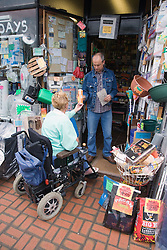 Woman wheelchair shopping in a hardware store,